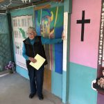 Sister of Mercy Betty Campbell of Casa Tabor in Ciudad Juárez, explains hand-written murals depicting victims of violent deaths in Latin America